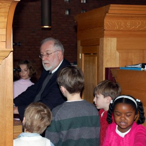 Dr. Bill Porter gives a demonstration of the organ to youngsters at the Bach Birthday 326 celebration