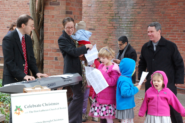 The musical Wessler family leads the singing supported by a trio of young carolers