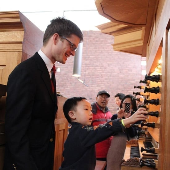 Balint Karosi and child explore the various stops of the organ