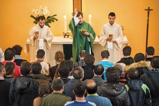 Refugees gather for communion and blessings as the Rev. Dr. Gottfried Martens leads worship on Sunday, Nov. 15, at the Dreieinigkeits-Gemeinde, a Selbständige Evangelisch-Lutherische Kirche (SELK) church in Berlin-Steglitz, Germany. (LCMS/Erik M. Lunsford)